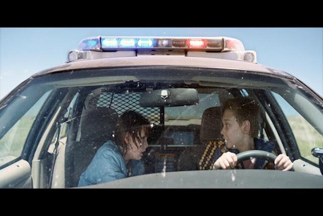 Cop Car Riding in Car